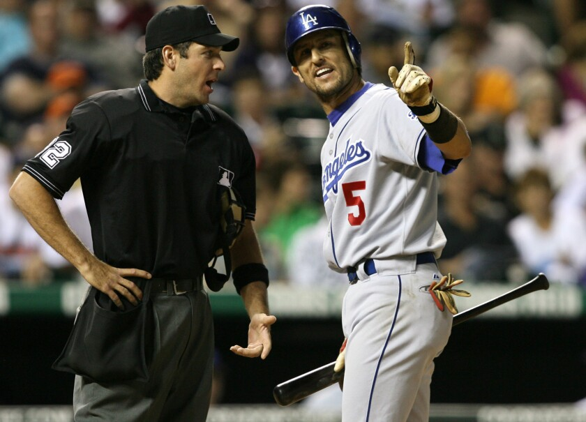 Los Angeles Dodgers' Nomar Garciaparra, right, argues with home plate umpire James Hoye after Hoye said Garciaparra struck out on a check swing to end the top of the eighth inning of a baseball game against the Colorado Rockies, Friday, June 9, 2006, in Denver. Los Angeles won 3-0.