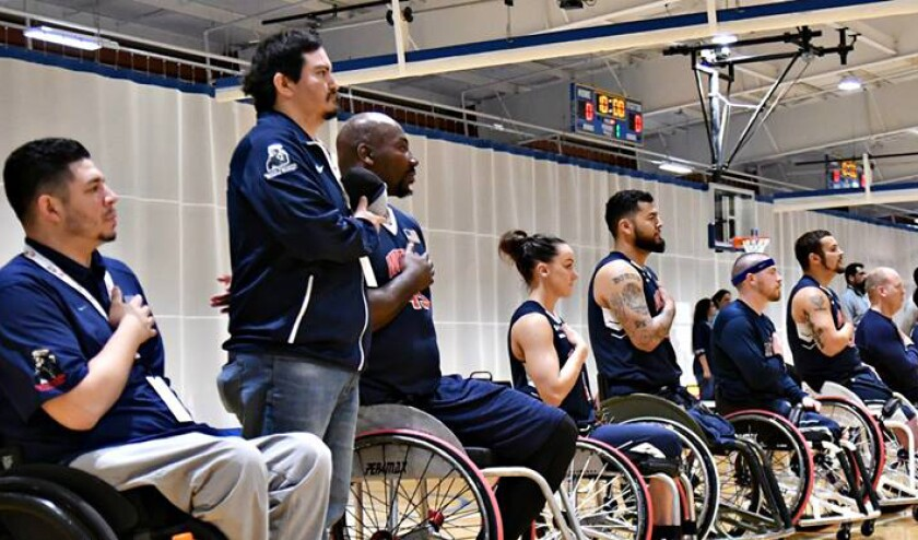 Megan Blunk, center, is the first and only woman to play for the Wolfpack, a traveling wheelchair basketball team made up of active-duty military and veterans.