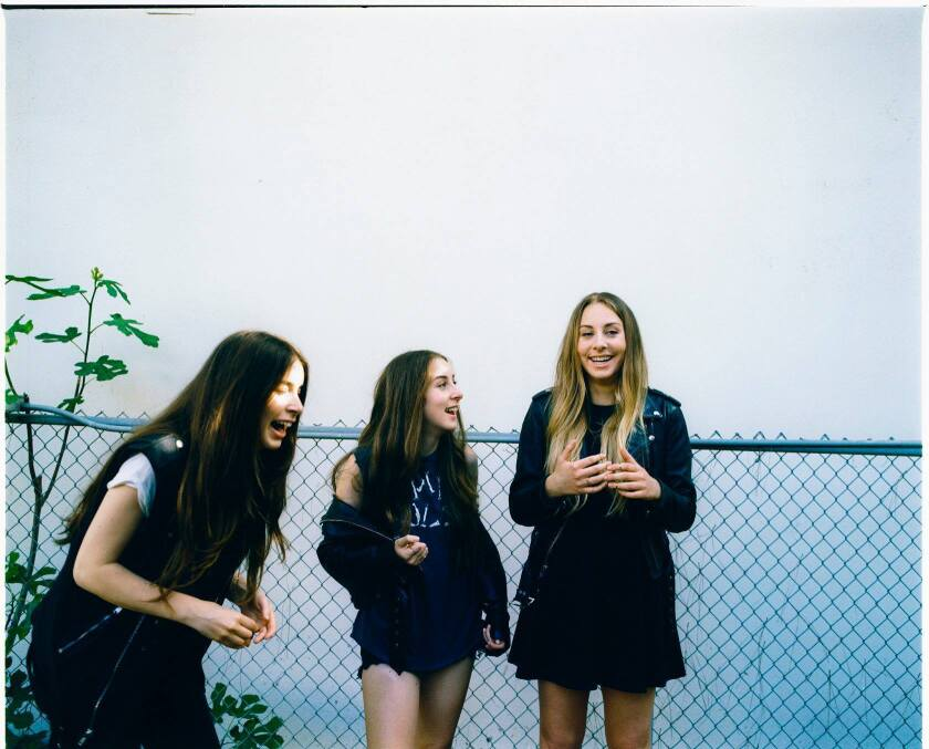 "The L.A. band Haim -- with sisters Danielle, left, Alana and Este -- recorded a cover of ""Wrecking Ball"" by Miley Cyrus for the BBC."