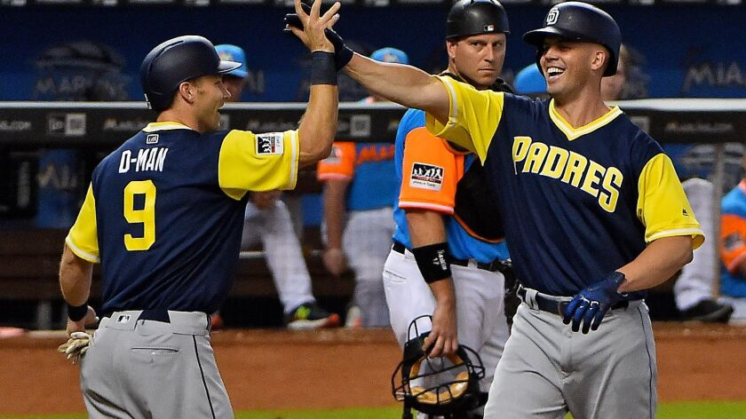Padres starting pitcher Clayton Richard (3) celebrates with shortstop Dusty Coleman (9) after his two run he run in the fifth inning at Marlins Park on Aug. 27, 2017.
