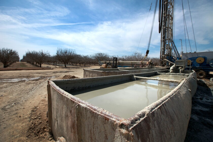 Fracking fluids flow into containment tanks on a fracked oil well near Bakersfield in March.