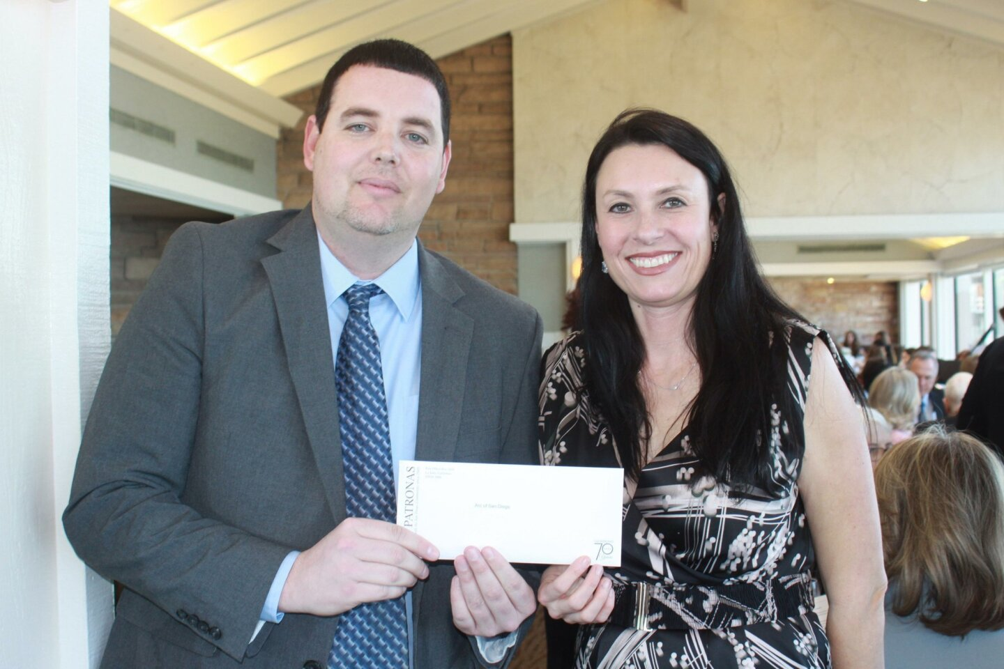 Chris Shilling and Jennifer Navarra from the Arc of San Diego with their check, which will fund exercise equipment for persons with disabilities.