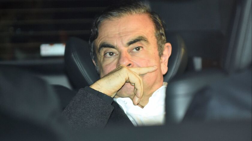 Former Nissan Chairman Carlos Ghosn leaves his lawyers' offices in Tokyo on March 6 after being released on bail from a detention center.