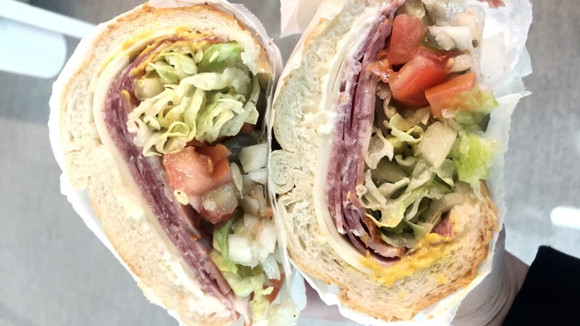 The Italian subs at Giamela's come with chopped tomato, onion and pickle.