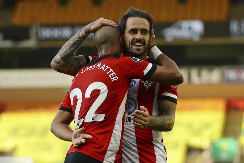 Southampton's Nathan Redmond, left, celebrates with his teammate Danny Ings scoring his side's third goal during the English Premier League soccer match between Norwich City and Southampton at Carrow Road in Norwich, England, Friday, June 19, 2020. (AP Photo/Richard Heathcote/Pool)
