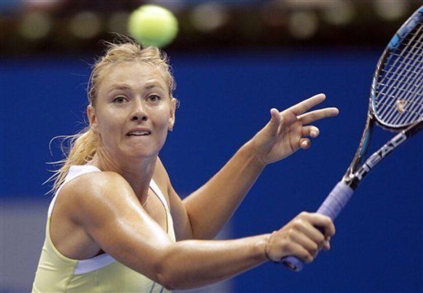 FILE - In this Dec. 7, 2012 file photo, Russia's Maria Sharapova eyes the ball during a Gillette Federer Tour exhibition tennis match with Denmark's Caroline Wozniacki in Sao Paulo, Brazil. No. 2-ranked Maria Sharapova has withdrawn from the Brisbane International before her opening match after feeling pain in her right collarbone during practice. The French Open champion on Tuesday, Jan. 1, 2013 said she would head immediately to Melbourne to start preparing for the Australian Open, starting Jan. 14. (AP Photo/Andre Penner, File)