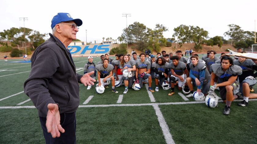 Pete Gumina, quarterback of San Diego High's 1955 mythical national championship team, talks to the current Cavers squad on Wednesday.
