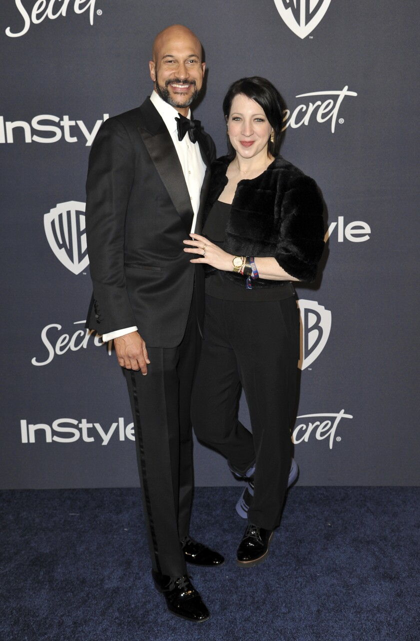 Keegan-Michael Key, left, and Elisa Key arrive at the InStyle and Warner Bros. Golden Globes afterparty at the Beverly Hilton Hotel on Sunday, Jan. 5, 2020, in Beverly Hills, Calif. (Richard Shotwell/Invision/AP)