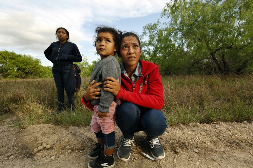 Lirio Funes, 20, with daughter Melissa, 2, after crossing the U.S.-Mexico border in McAllen, Texas.
