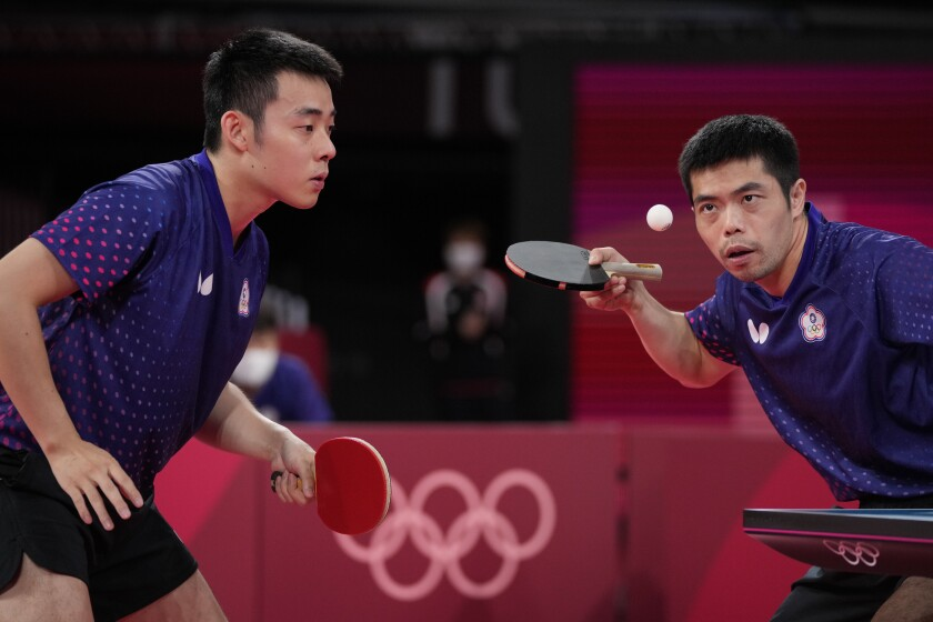 Taiwan's Chuang Chih-Yuan, right, and Chen Chien-an compete in table tennis at the Olympics.