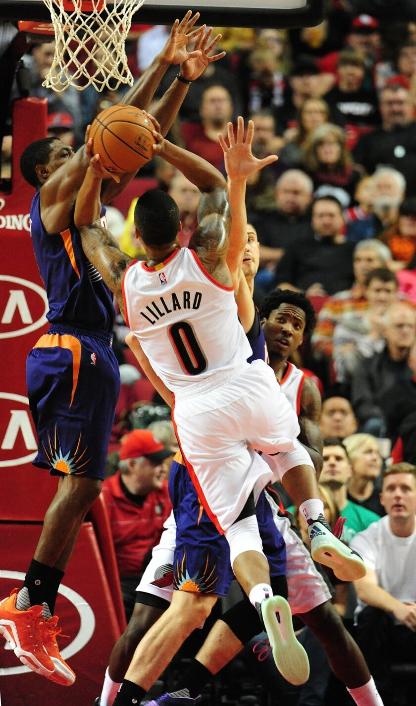 Portland Trail Blazers guard Damian Lillard (0) drives to the basket during the first quarter of an NBA basketball game against the Phoenix Suns in Portland, Ore., Saturday, Oct. 31, 2015. (AP Photo/Steve Dykes)