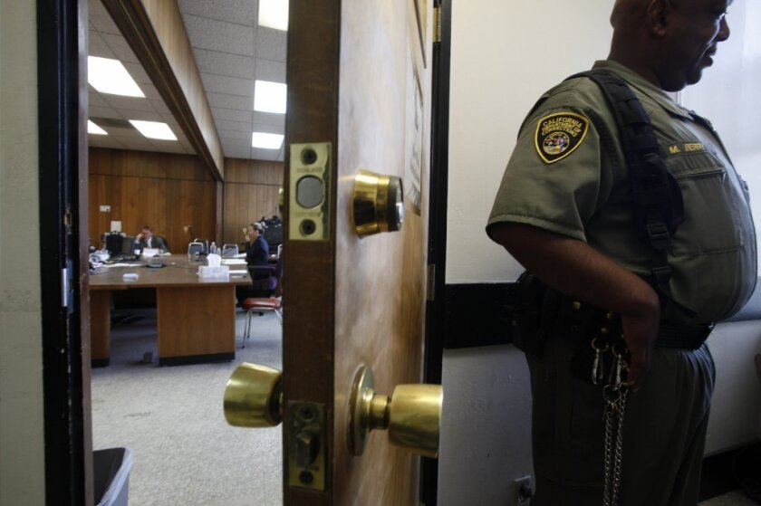 A California Deptartment of Corrections and Rehabilitation officer stands outside the parole hearing room at San Quentin State Prison on July 9.