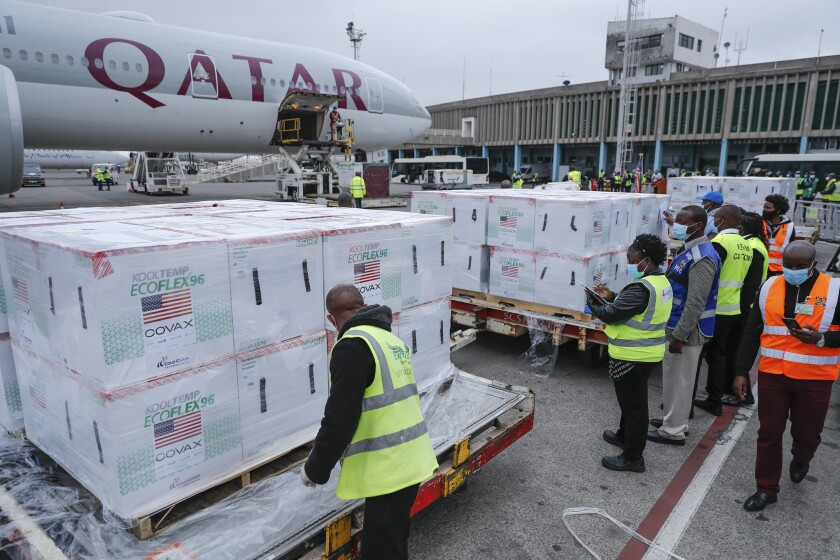 Airport officials receive boxes of Moderna coronavirus vaccine after their arrival at the airport in Nairobi, Kenya Monday, Sept. 6, 2021. 880,320 doses were delivered forming the second of two shipments totalling 1.76 million doses which were donated by the U.S. government via the COVAX facility, according to the U.S. embassy in Kenya. (AP Photo/Brian Inganga)