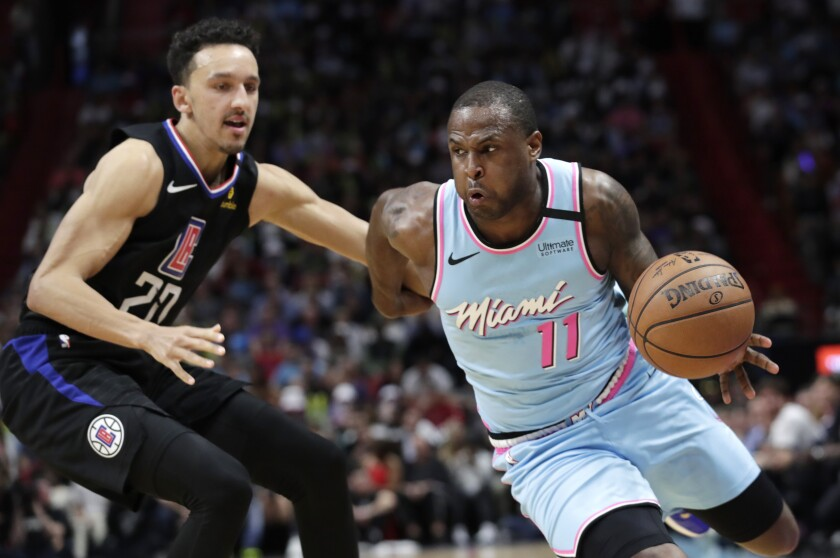 Dion Waiters drives past Clippers guard Landry Shamet on Jan. 24, 2020, in Miami.