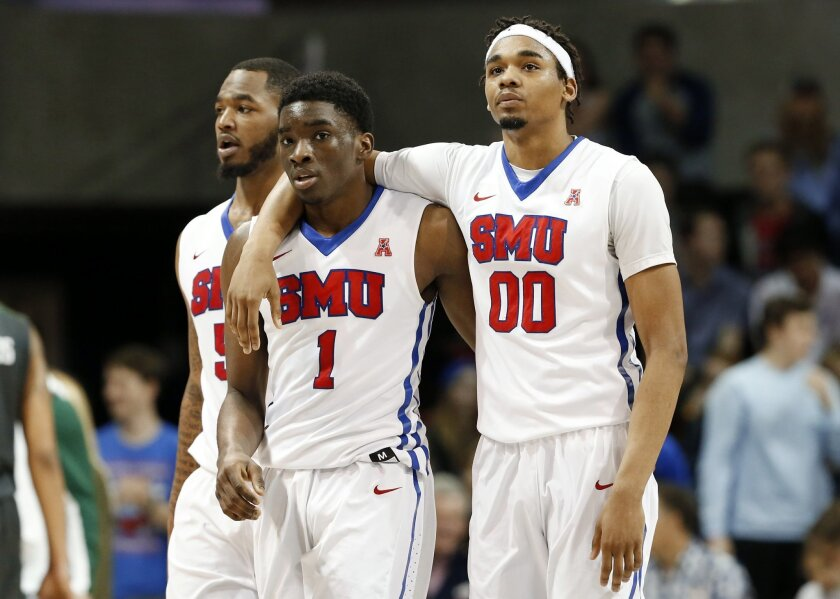 SMU's Markus Kennedy, Shake Milton (1) and Ben Moore walk to the bench during a a timeout in the second half of an NCAA college basketball game, Sunday, Feb. 28, 2016, in Dallas. (AP Photo/Brad Loper)