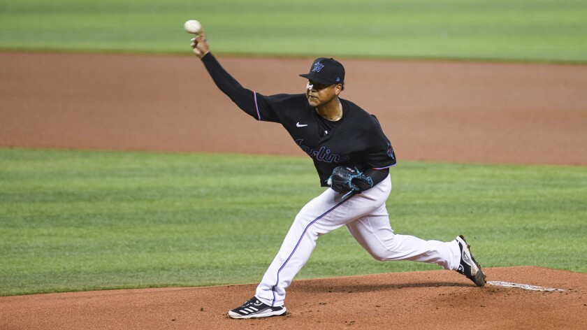 Miami Marlins starting pitcher Elieser Hernandez throws during the first inning of the team's baseball game against the Tampa Bay Rays, Saturday, April 3, 2021, in Miami. (AP Photo/Gaston De Cardenas)