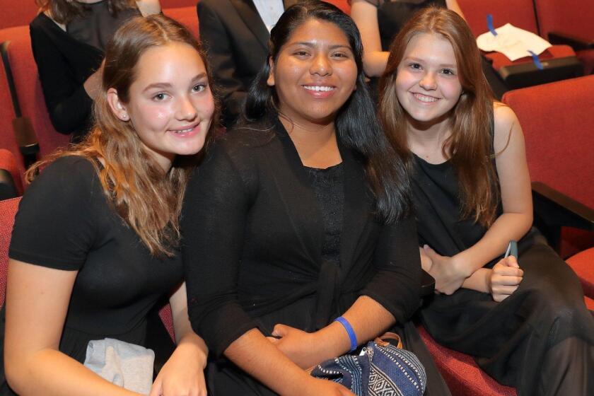 Choir members Philine Klas, Julia Atempa, Bri Baker