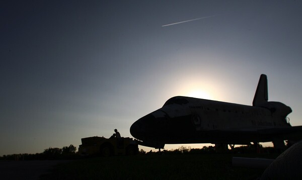 Space shuttle Discovery, STS-133, is towed from the shuttle runway back to the orbiter processing facility, ending its historic career after the crew of 6 astronauts made a picture-perfect landing Wednesday, March 9, 2011, at Kennedy Space Center.