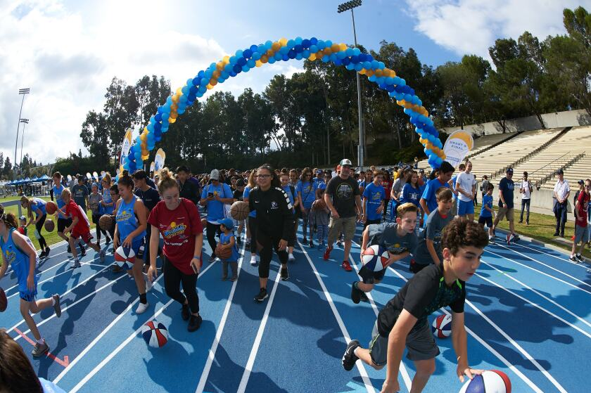 Children, their families and UCLA athletes take part in the 2018 Dribble for the Cure fundraiser.