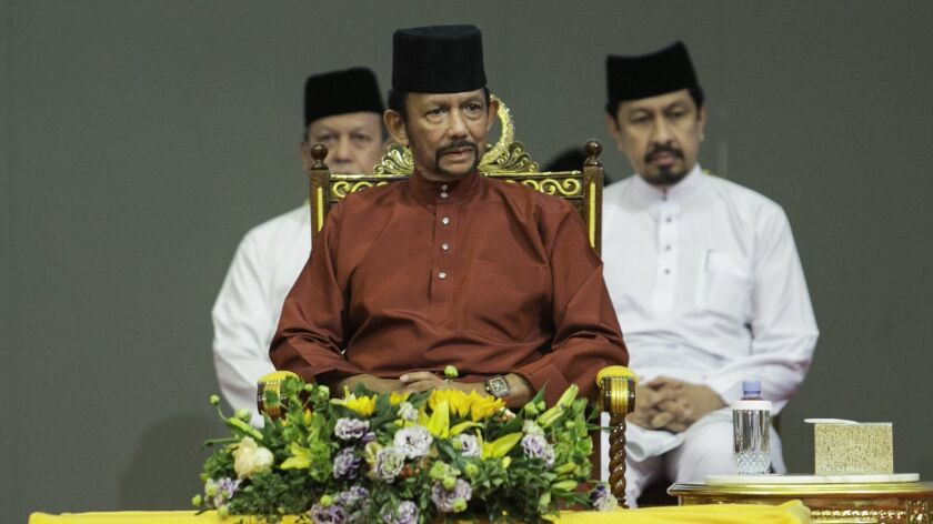 Brunei's sultan has announced that death by stoning for gay sex and adultery will not be enforced after a global backlash, but critics on Monday called for harsh sharia laws to be abandoned entirely.