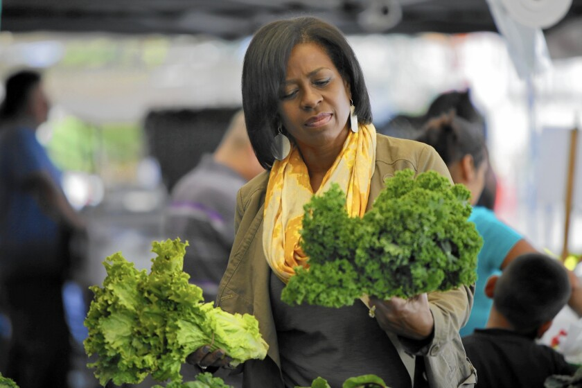 Donna Horton shops at the Baldwin Hills Crenshaw Plaza farmers market.