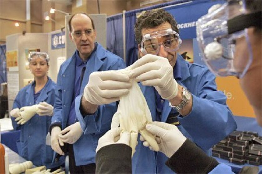 Lockheed Martin engineer Jim Kaplan (third from left) showed Sarath Pathuri of Mesa Verde Middle 