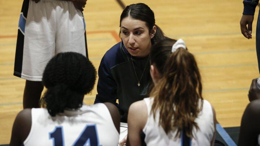 Granite Hills girls basketball coach Briana Martinez coaches her team against Godinez (Santa Ana, CA) on Saturday, December 29th, 2018 during a tournament game at Valhalla High School.