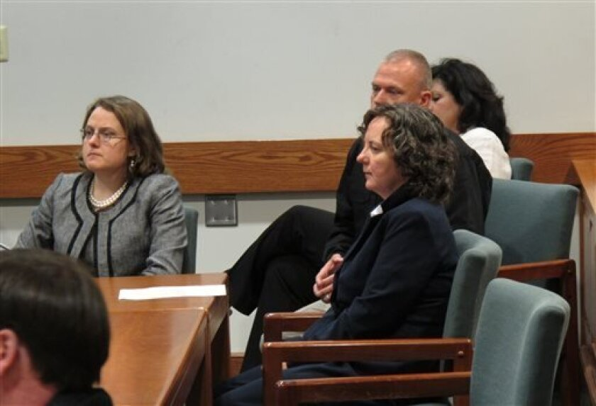 Susan Hendricks, front right, listens to a psychologist testify about her mental condition before she is sentenced to life in prison on Friday, April 26, 2013, in Pickens, S.C. Hendricks pleaded guilty but mentally ill to killing four family members in October 2011 in Liberty, S.C. Hendricks, 49, a