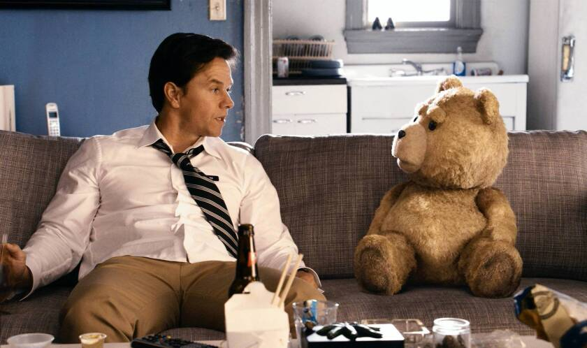 """Mark Wahlberg and his childhood teddy bear in """"Ted."""""""