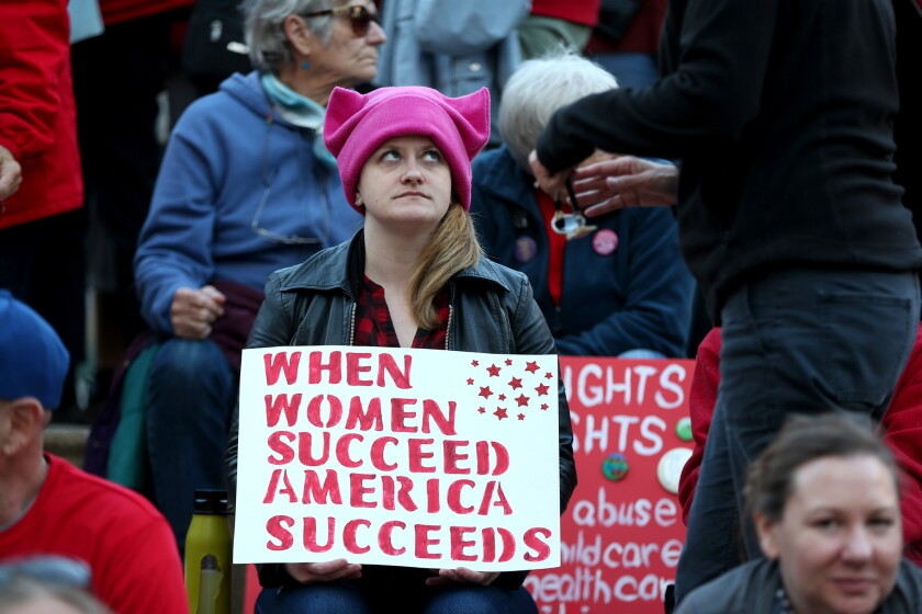 Demonstrators at a Day Without a Woman march in Oakland in 2018.