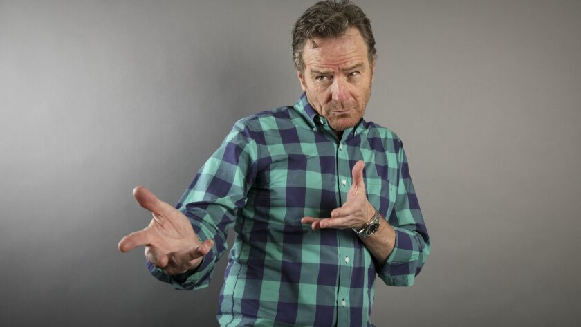 Actor Bryan Cranston gives his best Elvis impression as he poses for a portrait during the Los Angel