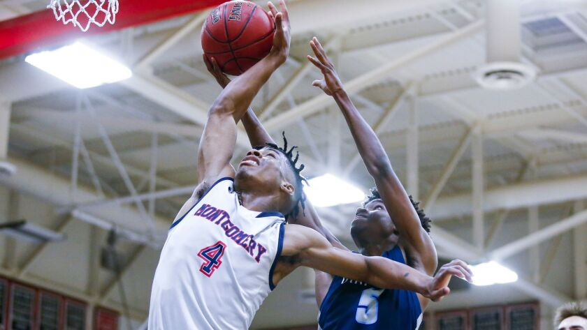 Montgomery's Rahin Williams blocks a shot from Otay Ranch's Ray King in the fourth period.