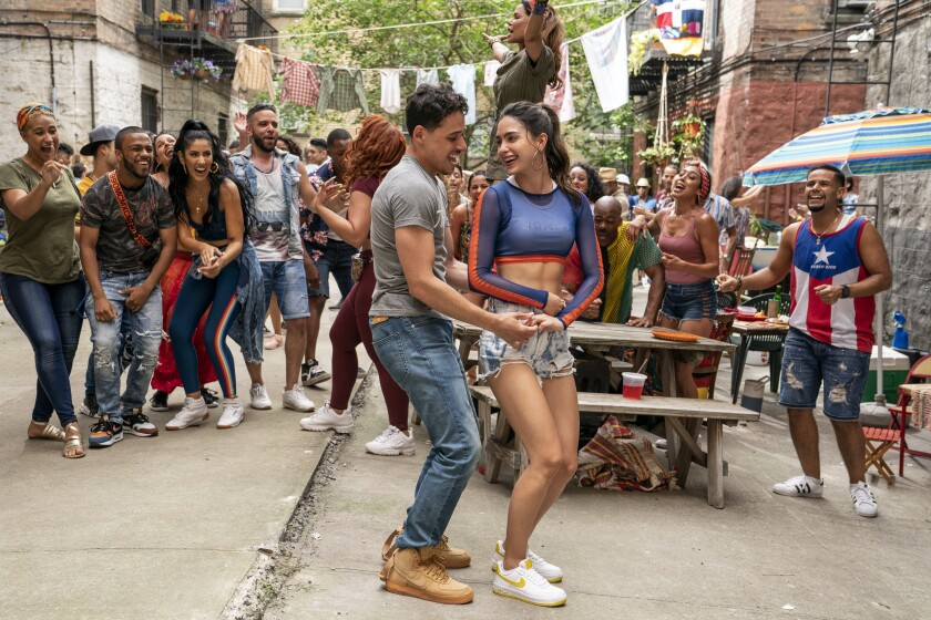"""Anthony Ramos and Melissa Barrera dance in a scene from the movie """"In the Heights."""""""