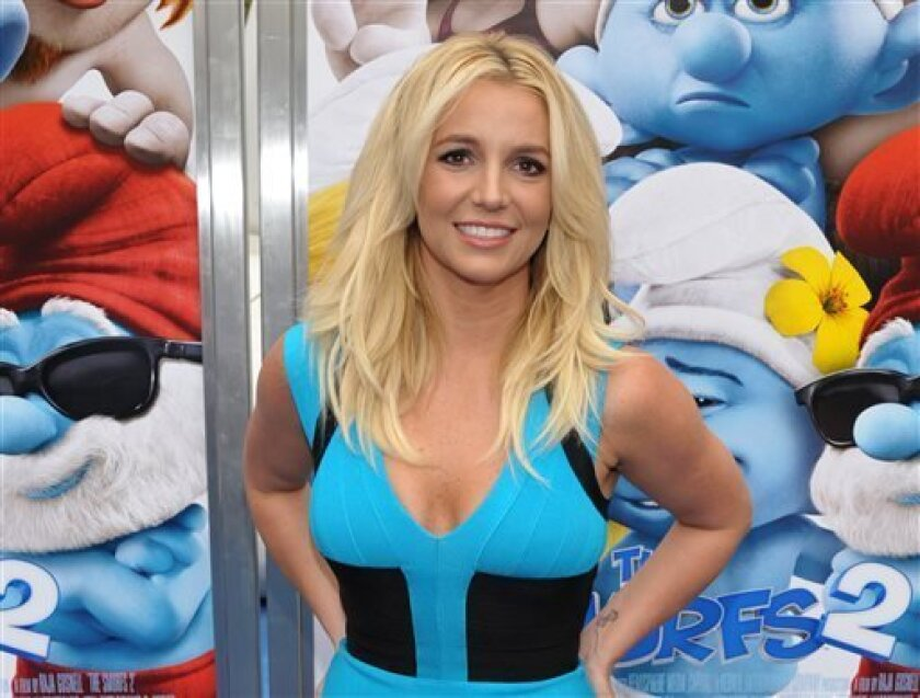 """FILE - In this July 28, 2013 file photo, singer Britney Spears arrives to the world premiere of """"The Smurfs 2"""" in Los Angeles. Spears announced a 16-date residency at Planet Hollywood Resort & Casino on ABC's """"Good Morning America"""" on Tuesday, Sept 17. """"Britney: Piece of Me"""" will debut Dec. 27. (Ph"""