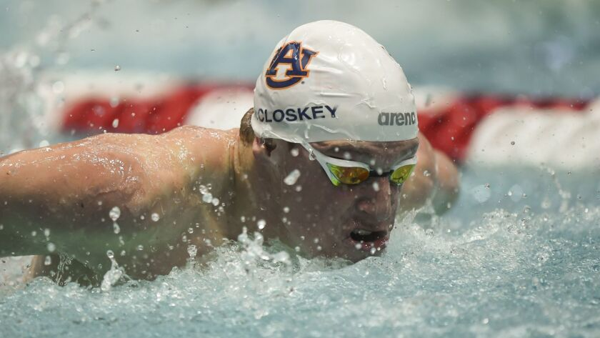 Liam McCloskey broke Salazar's section record in the 100-yard butterfly.