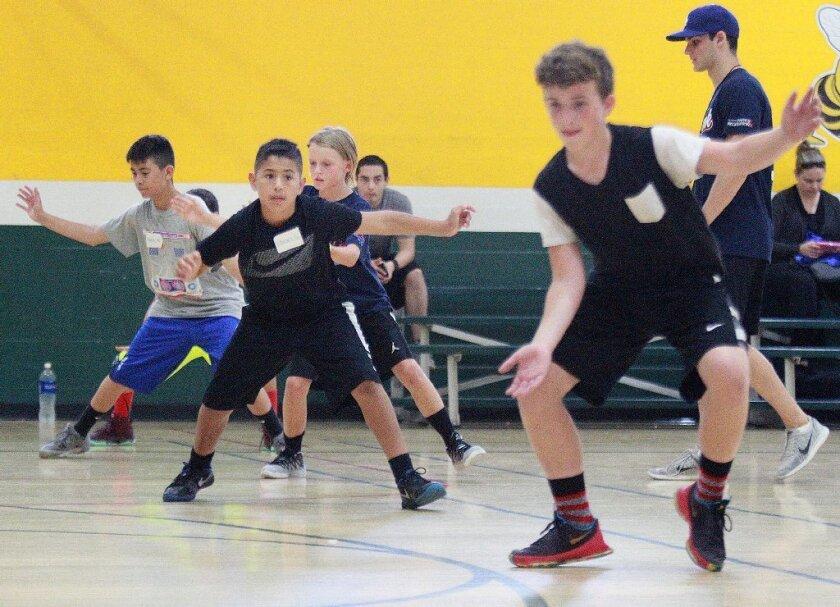 Athletes go through a drill at the 16th annual MVP Summer Basketball Camp.