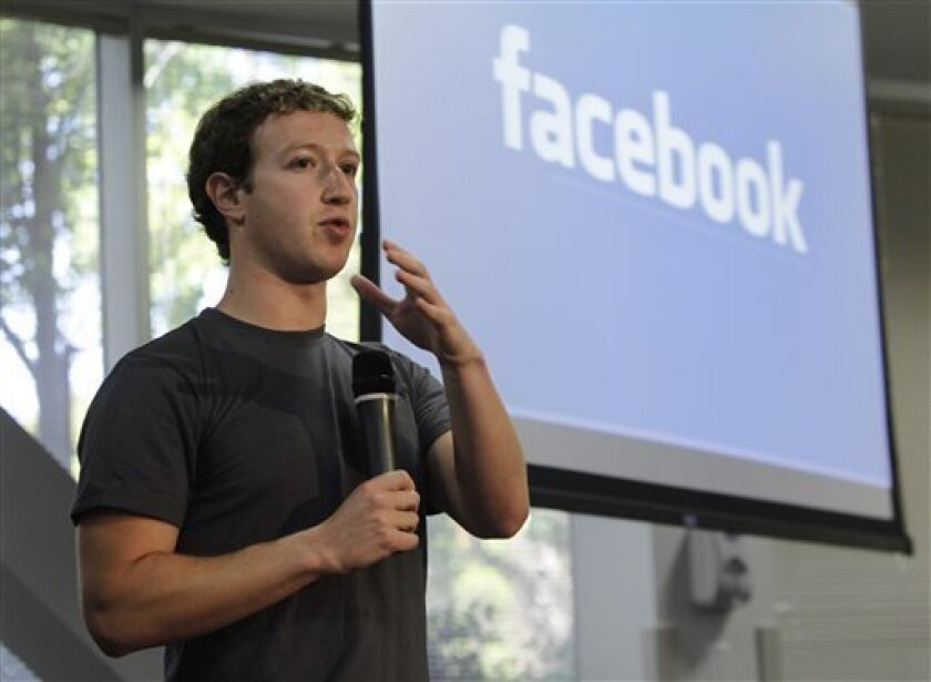 Facebook CEO Mark Zuckerberg gestures during a product announcement at Facebook headquarters in Palo Alto, Calif., Wednesday, Oct. 5, 2010. (AP Photo/Paul Sakuma)