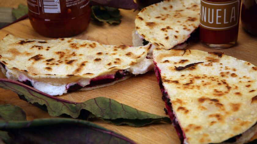 Beet green, roasted beets and goat cheese quesadillas.