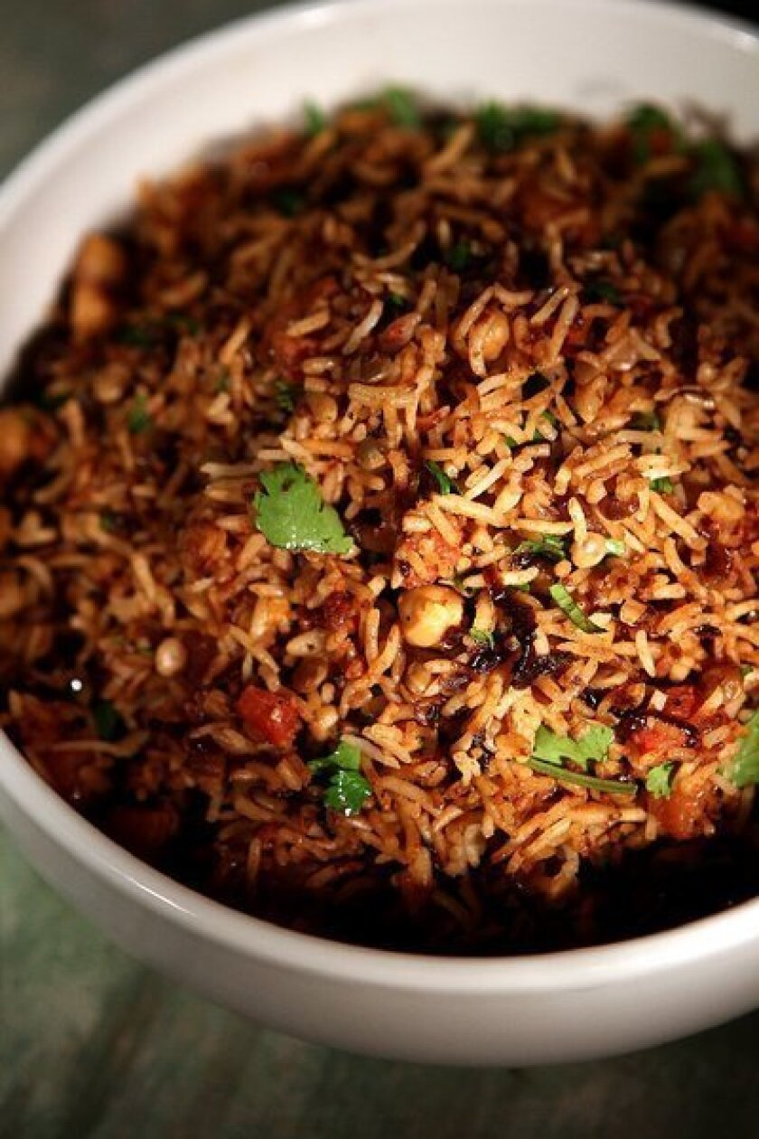 Rice pilaf with chickpeas, lentils and browned onions.