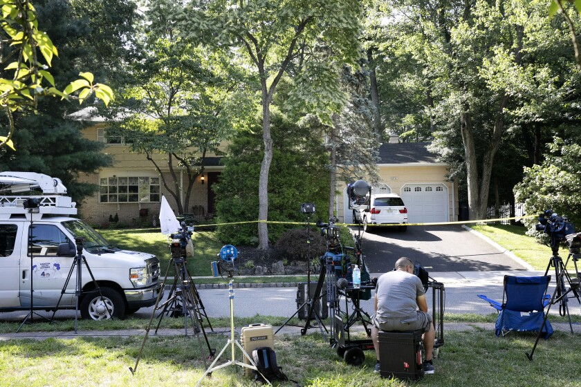 Members of the news media outside the home of U.S. District Judge Esther Salas.