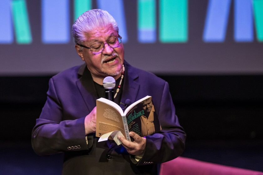 Luis J. Rodriguez reads a poem at the Colony Theatre in Burbank as part of the L.A. Times Book Club.
