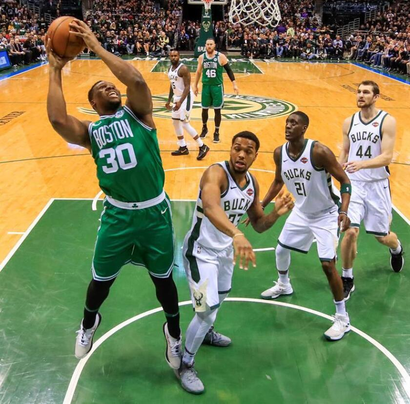 Boston Celtics forward Guerschon Yabusele of France (L) shoots over Milwaukee Bucks guard Sterling Brown (2L) Milwaukee Bucks guard Tony Snell (2R) and Milwaukee Bucks center Tyler Zeller (R) in the second half of their NBA Eastern Conference playoff game at the BMO Harris Bradley Center in Milwaukee, Wisconsin, USA, 20 April 2018. EFE