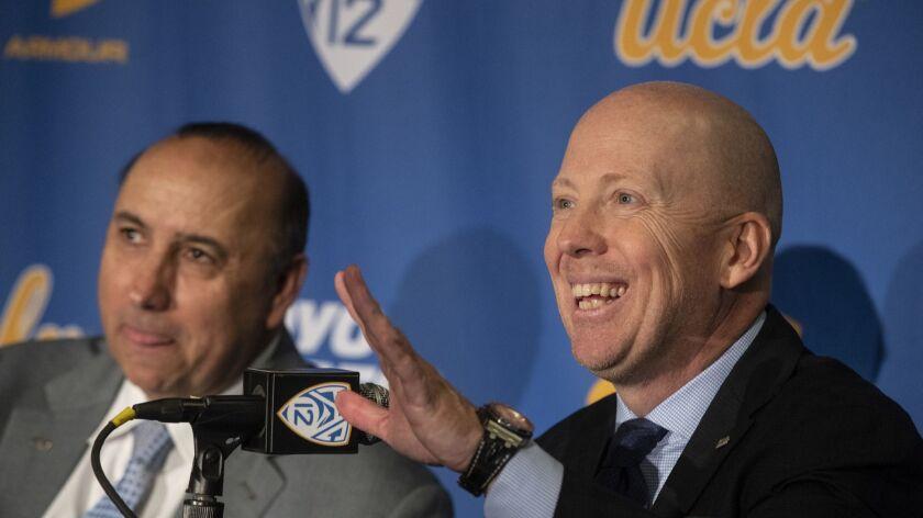 WESTWOOD, CALIF. -- WEDNESDAY, APRIL 10, 2019: UCLA Director of Athletics Dan Guerrero, left, and M