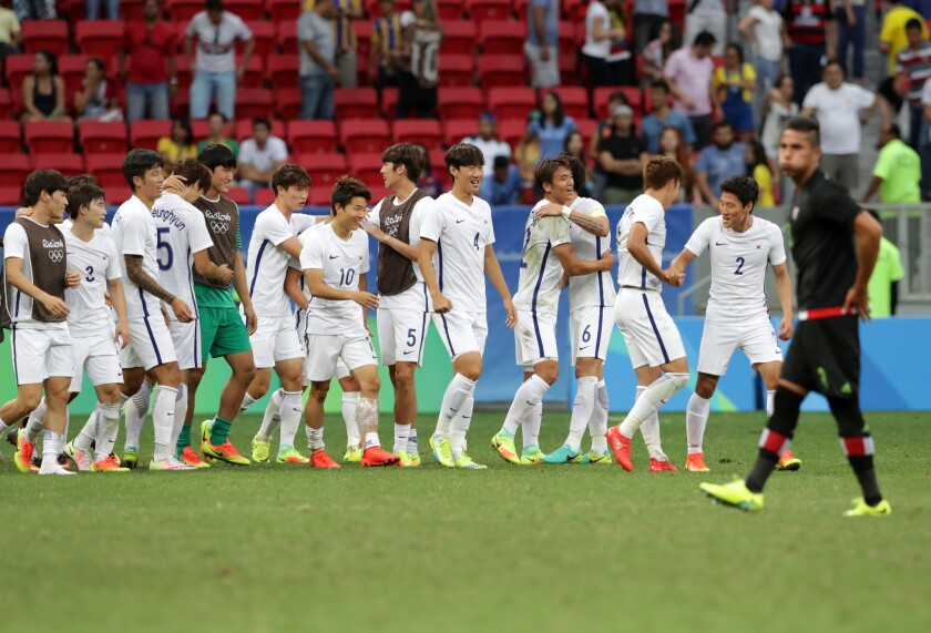 South Korea players celebrate after defeat Mexico 1-0 on a group C match of the men's Olympic football tournament at the National Stadium in Brasilia, Brazil, Wednesday, Aug. 10, 2016. (AP Photo/Eraldo Peres)