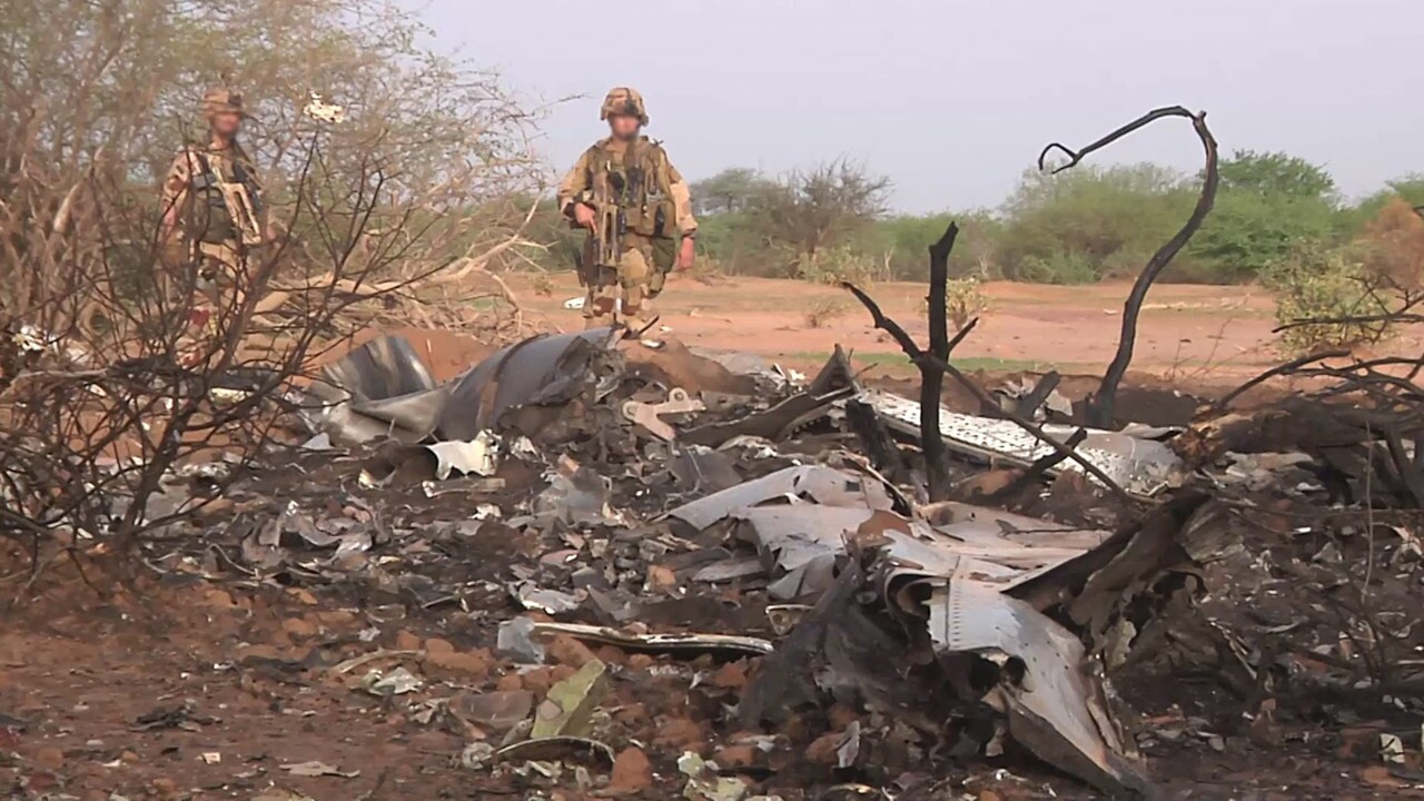 French soldiers survey some of the wreckage of Air Algerie Flight 5017 in the Gossi area of Mali. The plane bound from Burkina Faso to Algiers with 118 aboard crashed during a storm on Thursday.