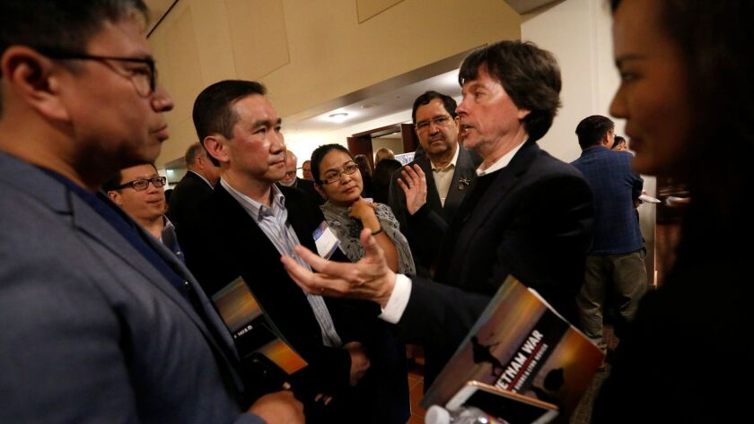IRVINE, CA - MAY 15, 2017 - Documentary filmmaker Ken Burns, second from right, speaks with Dr. Thom