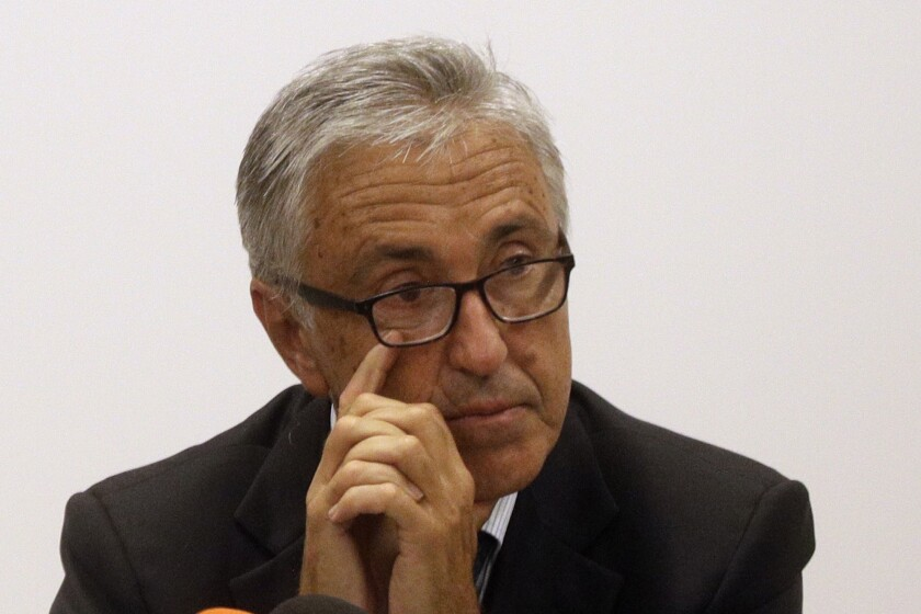 FILE - In this Aug. 18, 2018 file photo, Autostrade per L'Italia CEO Giovanni Castellucci attends a press conference in Genoa, Italy. Italian financial police on Wednesday issued arrest warrants against six current and former managers of Italy's main private highway operator as part of the investigation into the Genoa bridge collapse that killed 43 people in August 2018. Three - including Castellucci - have been put under house arrest as part of a probe into defects in highway barriers linked to the deadly bridge collapse, while another three faced restrictive measures. (AP Photo/Gregorio Borgia)