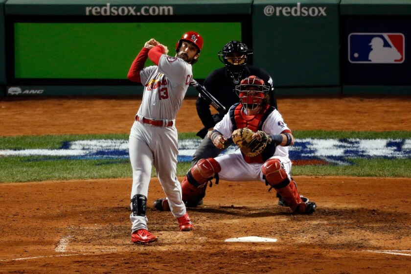 St. Louis second baseman Matt Carpenter drives in two runs on a bases-loaded sacrifice fly in the seventh inning of the Cardinals' 4-2 win over the Boston Red Sox in Game 2 of the World Series on Thursday.