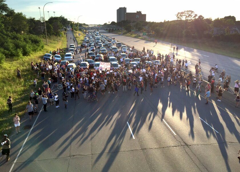 Marchers block part of Interstate 94 in St. Paul, Minn., Saturday, July 9, 2016, during a protest sparked by the recent police killings of black men in Minnesota and Louisiana. (Glen Stubbe/Star Tribune via AP)