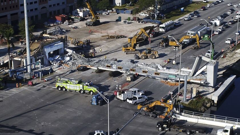Recovery operations continue at the site of the collapsed pedestrian bridge that near Florida Inter